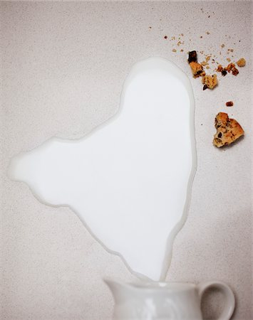 spill - Spilled milk from pitcher and cookie crumbs Stock Photo - Premium Royalty-Free, Code: 635-03577465