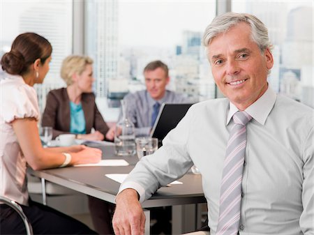 Smiling businessman in conference room Stock Photo - Premium Royalty-Free, Code: 635-03577726