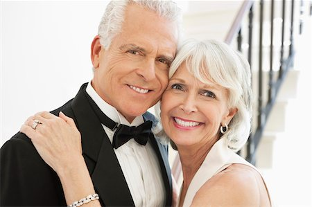 Close up of well-dressed senior couple smiling and hugging Stock Photo - Premium Royalty-Free, Code: 635-03577817
