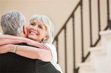 Smiling senior couple hugging Stock Photo - Premium Royalty-Free, Code: 635-03577820