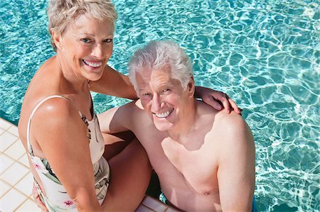 Smiling senior couple in swimming pool Stock Photo - Premium Royalty-Free, Code: 635-03577895