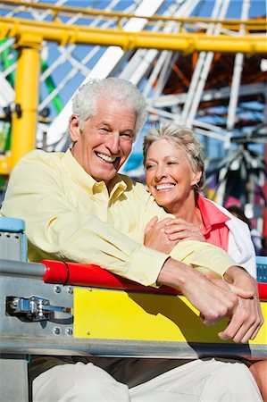 Smiling senior couple on amusement park ride Stock Photo - Premium Royalty-Free, Code: 635-03577898