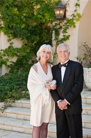 Well-dressed senior couple smiling Stock Photo - Premium Royalty-Free, Code: 635-03577912