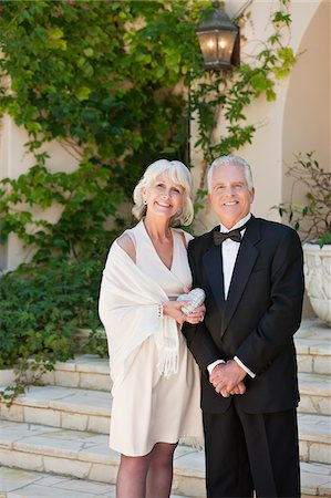 Well-dressed senior couple smiling Stock Photo - Premium Royalty-Free, Code: 635-03577912