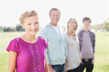 Smiling girl with family outdoors Stock Photo - Premium Royalty-Free, Code: 635-03578003