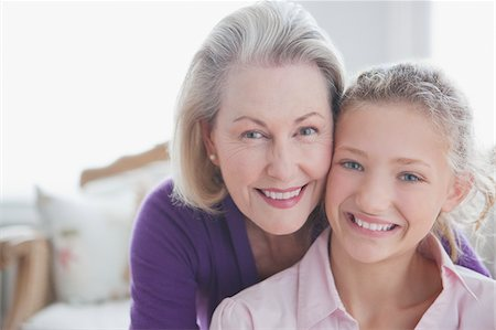 Close up of smiling grandmother and granddaughter Stock Photo - Premium Royalty-Free, Code: 635-03578034