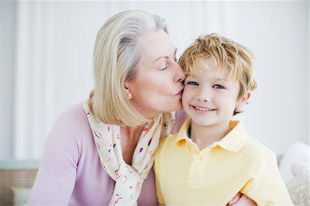 Grandmother kissing grandson's cheek Stock Photo - Premium Royalty-Free, Code: 635-03578068