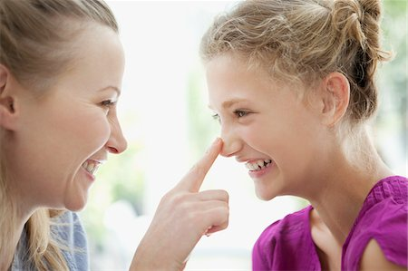 preteens fingering - Smiling mother touching daughter's nose Stock Photo - Premium Royalty-Free, Code: 635-03578072