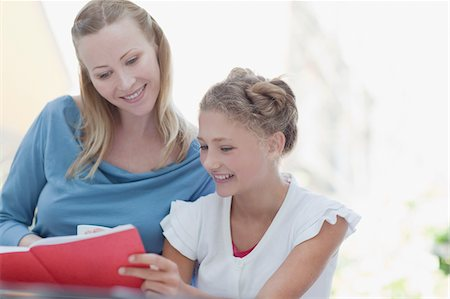 school work - Mother and daughter reading book Stock Photo - Premium Royalty-Free, Code: 635-03578114