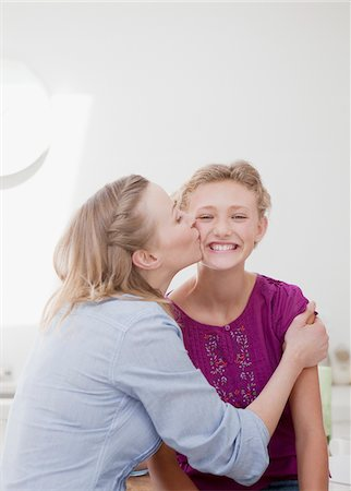 preteen kissing - Mother hugging and kissing smiling daughter Stock Photo - Premium Royalty-Free, Code: 635-03578118