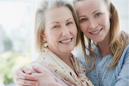 Close up of smiling mother and daughter hugging Stock Photo - Premium Royalty-Free, Code: 635-03578125