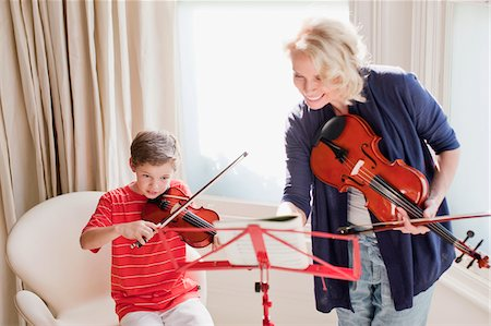 sheet music - Woman and boy playing violin Stock Photo - Premium Royalty-Free, Code: 635-03641441