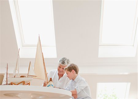 Father and son assembling model sailboat Stock Photo - Premium Royalty-Free, Code: 635-03641457