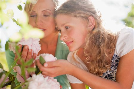 Mother and daughter smelling flowers Stock Photo - Premium Royalty-Free, Code: 635-03641518
