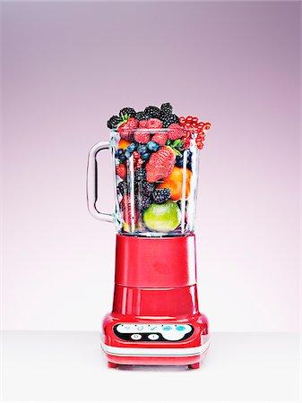 Variety of fruit crammed in blender Stock Photo - Premium Royalty-Free, Code: 635-03641699