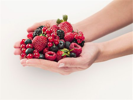 Woman holding berries Stock Photo - Premium Royalty-Free, Code: 635-03641731