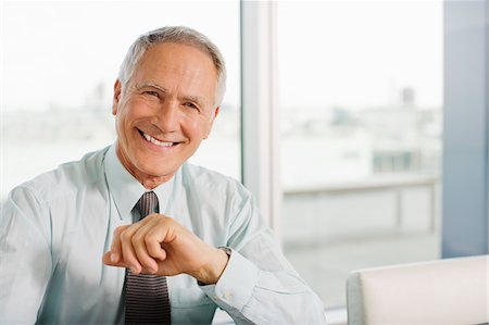 Smiling businessman Stock Photo - Premium Royalty-Free, Code: 635-03641992
