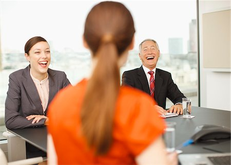 Business people laughing in conference room Stock Photo - Premium Royalty-Free, Code: 635-03642010