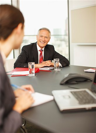 Smiling business people having a meeting in conference room Stock Photo - Premium Royalty-Free, Code: 635-03642044