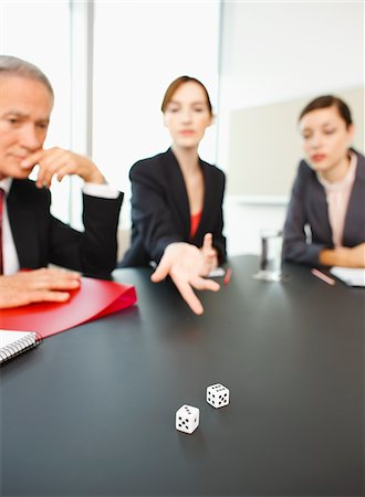 results - Business people throwing dice on conference room table Stock Photo - Premium Royalty-Free, Code: 635-03642042