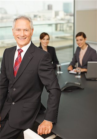 Smiling business people in conference room Stock Photo - Premium Royalty-Free, Code: 635-03642066