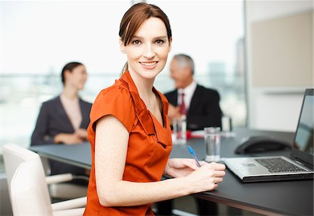 Smiling businesswoman with laptop in conference room Stock Photo - Premium Royalty-Free, Code: 635-03642068