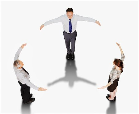 Business people forming circle with outstretched arms Stock Photo - Premium Royalty-Free, Code: 635-03642104