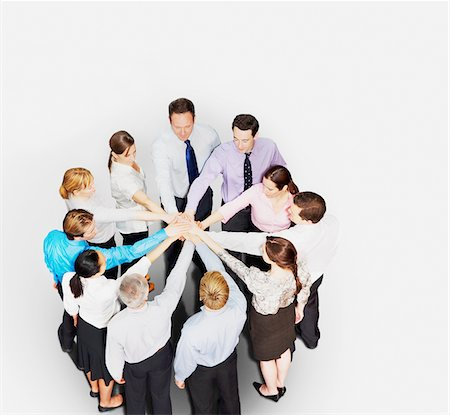 Business people in circle stacking hands Stock Photo - Premium Royalty-Free, Code: 635-03642106