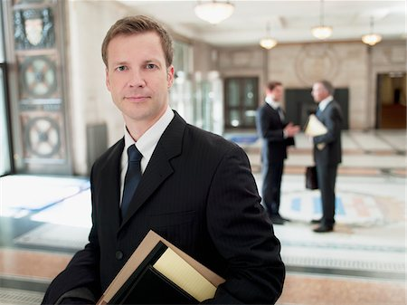 Smiling lawyer in lobby Stock Photo - Premium Royalty-Free, Code: 635-03642118