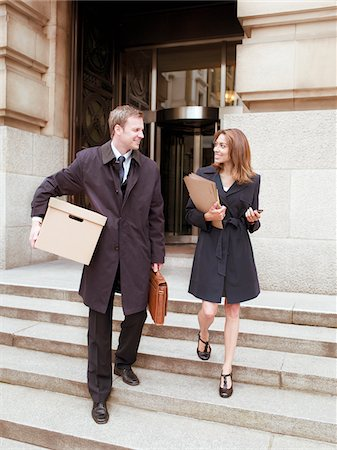 Lawyers leaving courthouse with files and box Stock Photo - Premium Royalty-Free, Code: 635-03642131