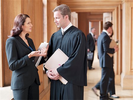 Judge and lawyer talking in corridor Stock Photo - Premium Royalty-Free, Code: 635-03642156