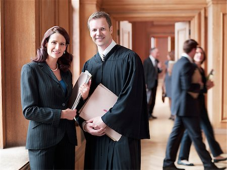 Smiling judge and lawyer in corridor Stock Photo - Premium Royalty-Free, Code: 635-03642158