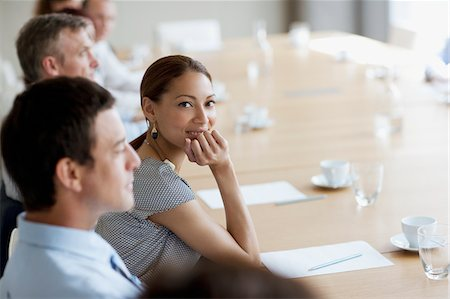 Smiling businesswoman in meeting in conference room Stock Photo - Premium Royalty-Free, Code: 635-03642171