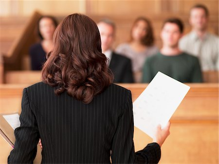 Lawyer holding document and speaking to jury in courtroom Stock Photo - Premium Royalty-Free, Code: 635-03642187