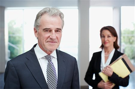 Smiling business people in office Stock Photo - Premium Royalty-Free, Code: 635-03642181
