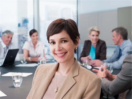 Smiling businesswoman in conference room Stock Photo - Premium Royalty-Free, Code: 635-03642193