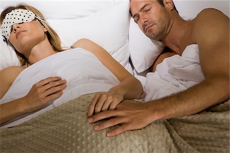 Couple sleeping in bed holding hands Stock Photo - Premium Royalty-Free, Code: 635-03684850