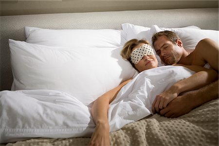 Couple sleeping in bed together Stock Photo - Premium Royalty-Free, Code: 635-03684852