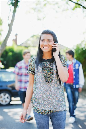 person walking on parking lot - Teenage girl talking on cell phone Stock Photo - Premium Royalty-Free, Code: 635-03684884