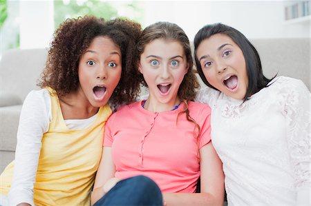 front row seat - Surprised teenage girls Stock Photo - Premium Royalty-Free, Code: 635-03684923