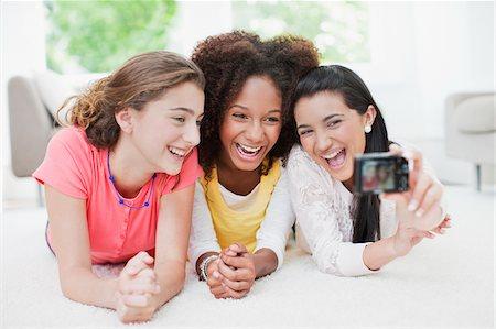 front row seat - Laughing teenage girls taking self-portrait Stock Photo - Premium Royalty-Free, Code: 635-03685014