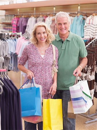 Couple carrying shopping bags in store Stock Photo - Premium Royalty-Free, Code: 635-03685088