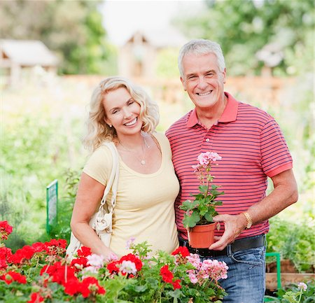 Couple shopping for flowers in nursery Stock Photo - Premium Royalty-Free, Code: 635-03685091