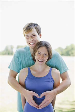 expectation - Smiling couple using hands to make heart shape Stock Photo - Premium Royalty-Free, Code: 635-03685187
