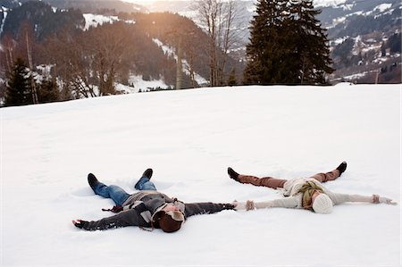 Couple making snow angels Stock Photo - Premium Royalty-Free, Code: 635-03685225