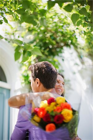 flower greeting - Man surprising girlfriend with bouquet of roses Stock Photo - Premium Royalty-Free, Code: 635-03685245