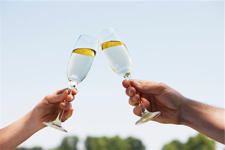 Couple drinking Champagne and toasting Stock Photo - Premium Royalty-Free, Code: 635-03685242