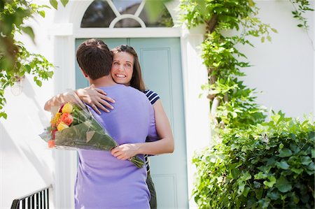 flower greeting - Man surprising girlfriend with bouquet of roses Stock Photo - Premium Royalty-Free, Code: 635-03685265