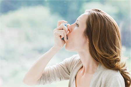 prevention - Woman using asthma inhaler Stock Photo - Premium Royalty-Free, Code: 635-03685336
