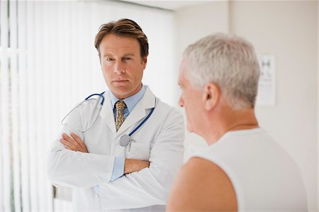 superior - Doctor with patient in doctor's office Stock Photo - Premium Royalty-Free, Code: 635-03685350
